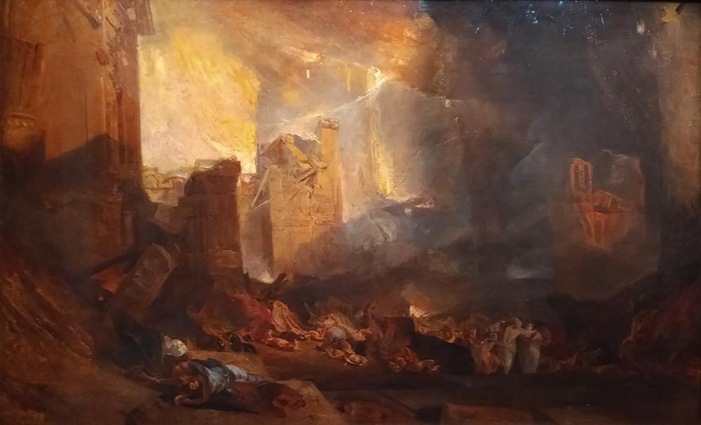 le tableau montre les ruines d'une ville, les maisons en pierre sont effondrées et des corps sont allongés au premier plan.