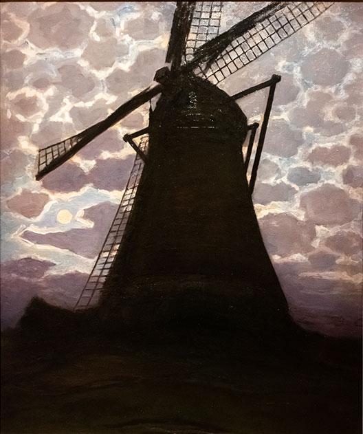 Moulin noir avec ciel nocturne.