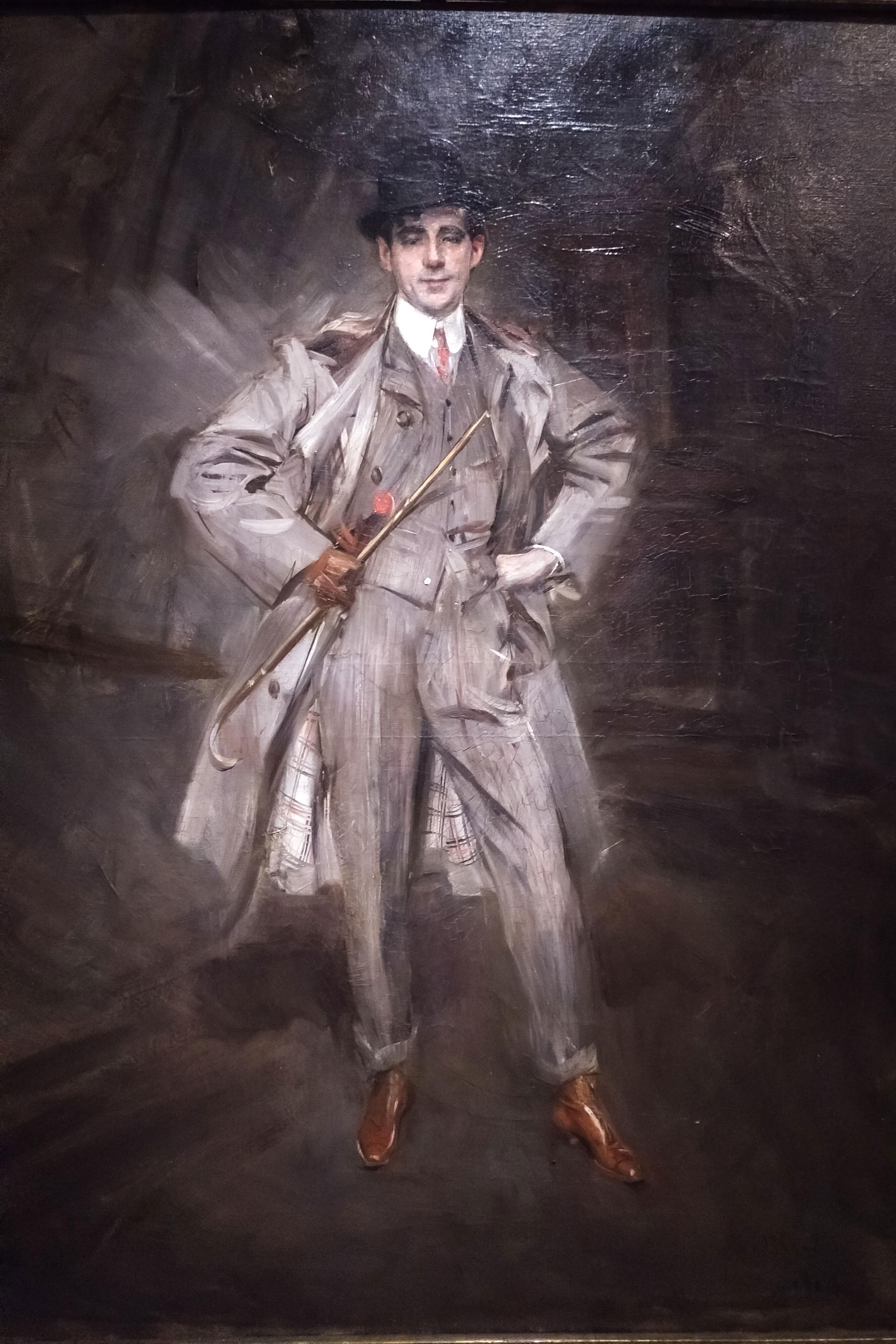 toile représentant un homme montrant fièrement sa tenue et ses chaussures